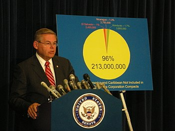 Senator Bob Menendez holding a press conferenc...