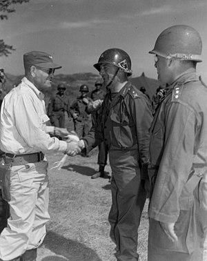Tahsin Yazıcı - Brigadier Tahsin Yazıcı, commander of the Turkish Brigade (center) greets Lieutenant General Frank W. Milburn, commander of US I Corps, upon his arrival at Brigade Headquarters, Korea, to attend a Turkish celebration on July 6, 1951.