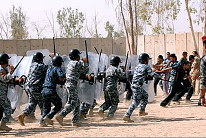 Civil disorder - Image: Ministry of Interior Iraqi Federal Police perform a riot control demonstration in the civil disorder management course on Camp Dublin, Baghdad, Iraq, Aug 20, 2011 110820 A QM174 104