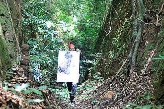 Yoruba art - Multidisciplinary designer Olufeko inside world heritage site Sungbo's Eredo with Philosophers Legacy heirloom in 2017