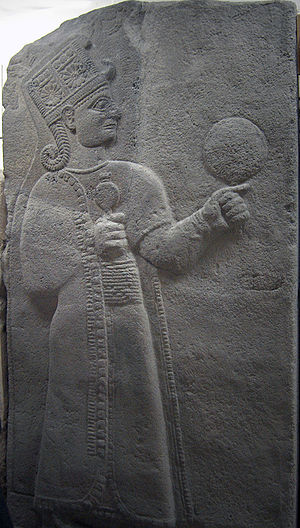 Kubaba - Kubaba holding a poppy capsule (possibly a pomegranate) and a tympanum (or perhaps a mirror) Museum of Anatolian Civilizations, Ankara, Turkey