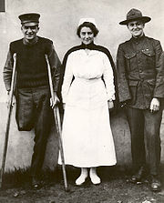 Navy Nurse Hazel Herringshaw stands with two of her patients -- 1918