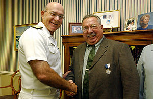 Navy Times - John Burlage receiving the United States Navy Superior Public Service Award in 2002