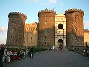 """The Castel Nuovo (""""New Castle"""") was renovated and chosen as his palace by Charles I of Anjou. The entrance is decorated by a Renaissance Arch of Triumph celebrating the entrance in the city of the Aragonese king Alfonso I (15th century)"""