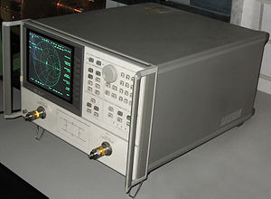 Smith chart - A network analyzer (HP 8720A) showing a Smith chart.