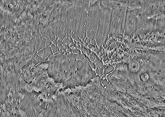 Noctis Labyrinthus - High resolution THEMIS daytime infrared image mosaic of Noctis Labyrinthus and its surroundings. The area is crisscrossed by multiple sets of graben running in different directions. The shield volcano Pavonis Mons is at upper left.