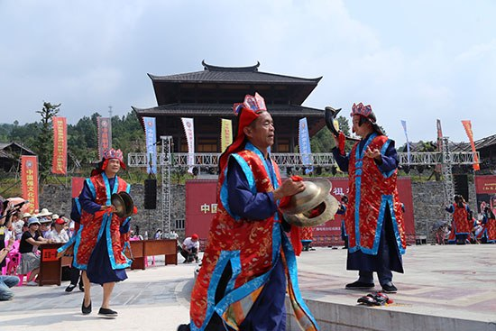 Nuo priests performing ritual at Chiyou Nuo Temple in Xinhua, Hunan