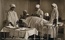 Nurses and patient in the operating theatre Wellcome V0049903.jpg