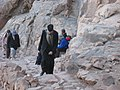 Orthodox priest walking up Mount Sinai (Egypt).jpg