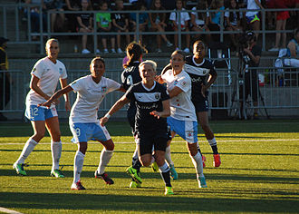 Maribel Domínguez - Domínguez (second from left) playing for the Chicago Red Stars in a match against Seattle Reign FC on 25 July 2013 in Tukwila, Washington.
