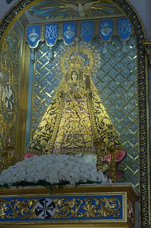 Ivory - The solid ivory image of Our Lady of Manaoag in her imperial regalia.  Genuine ivory is held more valuable than gold among Santero artisans. Pangasinan, Philippines.