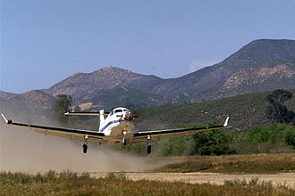 Pilatus PC-12 - Pilatus PC-12 taking off from a short unpaved airstrip