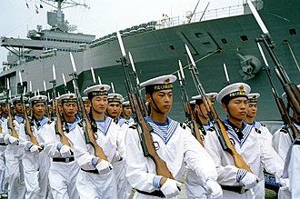 People's Liberation Army Navy - PLAN sailors at the Qingdao, North Sea Fleet headquarters parading with Type-56 carbines in 2000 for a visiting U.S. Navy delegation.
