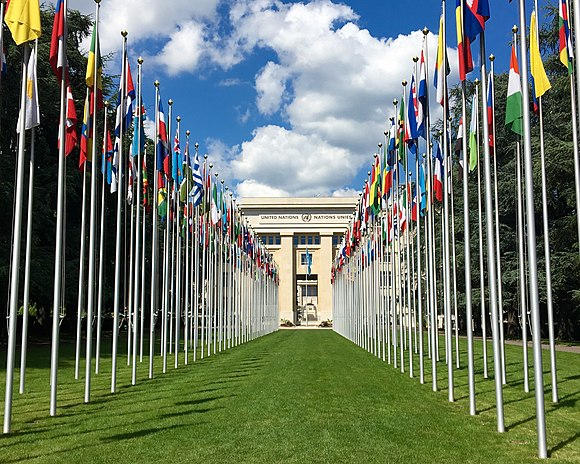 Flags of the United Nations member and non-member observer states in front of the Palace of Nations in Geneva, Switzerland