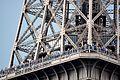 Part of Eiffel Tower with numerous tourist on it, Paris 2014.jpg