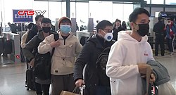 Passengers lining up in Wuhan railway station for their body temperature to be checked during the Wuhan coronavirus outbreak.jpg