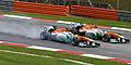 Paul di Resta overtaking Adrian Sutil 2013 Malaysia.jpg