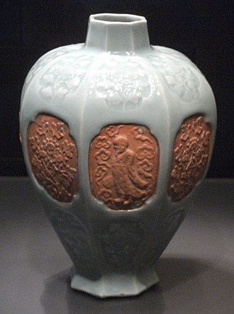 Longquan celadon - Vase with unglazed medallions, here using moulds and a resist technique, 14th century.