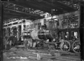 Petone Railway Workshops. Interior view of the Erecting Shop, lifting a boiler. ATLIB 285745.png