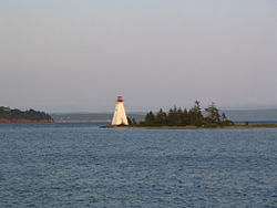 The Kidston Island Lighthouse which also appears on the village seal.