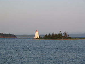 Baddeck - The Kidston Island Lighthouse which also appears on the village seal.