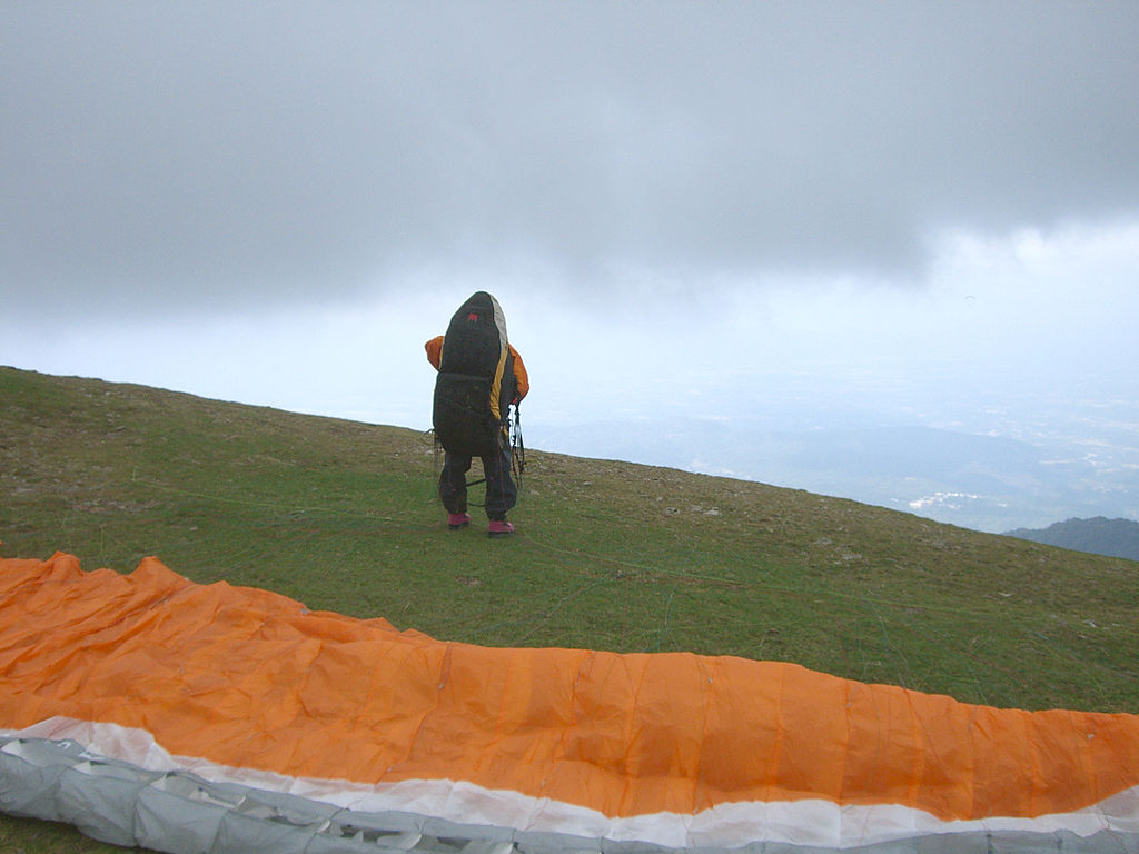 Pilot on a paragliding takeoff at Bir-Billing