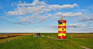 Pilsum lighthouse lighthouse in red and yellow in Lower Saxony, Germany