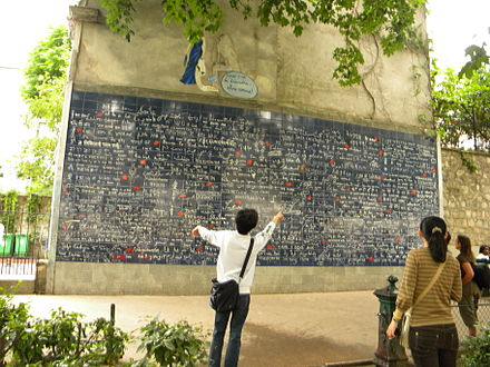 "The Wall of Love in Paris, where the phrase ""I love you"" is featured in 250 languages of the world Place des Abbesse (the plaque with the je t'aime=te iubesc in 311 laguages).jpg"