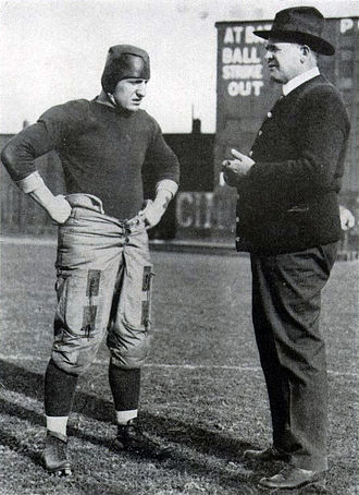 "Bob Peck (American football) - Peck with head coach ""Pop"" Warner during the 1916 season. That year, Pitt outscored its opponents 255–25 along the way to an 8–0 record and a consensus National Championship."