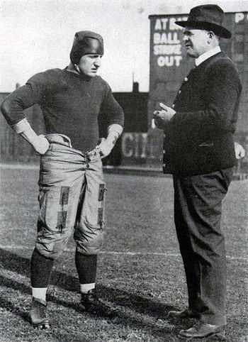 "Hall of fame head football coach ""Pop"" Warner (right) with three-time All-American and team captain Bob Peck during the 1916 national championship season PopandPeck1918Owl.jpg"