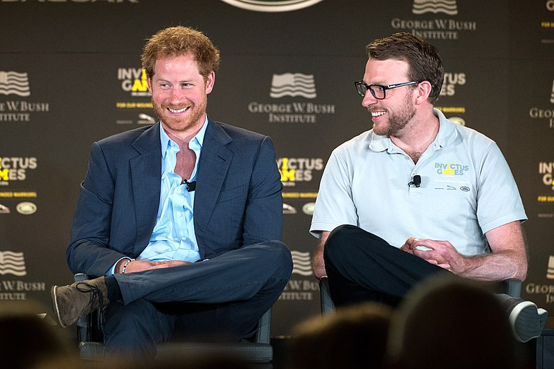 Prince Harry and former Royal Marine and Invictus competitior John-James Chalmers react during the 2016 Invictus Games Symposium on Invisible Wounds (26292600724).jpg