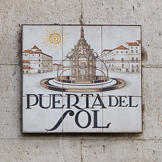 Puerta del Sol - Tiled street-sign of Puerta del Sol with a historic depiction of the square