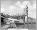 Queensland State Archives 3615 Main bridge erection stage 3 tower traveller at main pier main posts erected Brisbane 8 February 1938.png