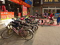 Qufu - electric bikes parked - P1060311.JPG
