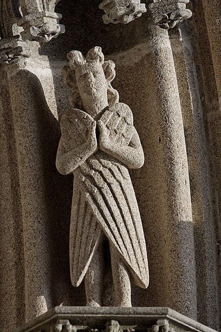 One of the angels in the west porch voussures