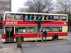 A bus in Manchester being decorated to represent Respect during an election campaign.