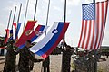 Raising the flags (7273917208).jpg