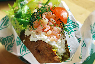 Baked potato - A baked potato with shrimp, cottage cheese, dill, tomato and lettuce