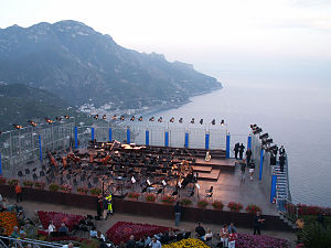 Music of Campania - The annual Festival of Ravello is a popular music venue in Italy. Here, an orchestra starts to set up on a stage overlooking the Amalfi coast.