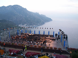 Music of Italy - The annual Festival of Ravello is a popular music venue in Italy. Here, an orchestra starts to set up on a stage overlooking the Amalfi coast.