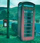 Red telephone box and post box at the Glen Café, St Mary's Loch, Selkirkshire, Scotland.jpg