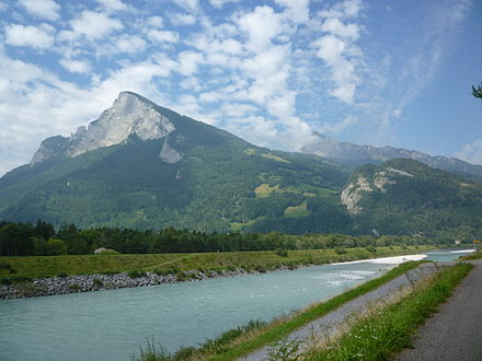 The Rhine between Sargans (CH, left) and Balzers (Liechtenstein, right) with the Gonzen (1,829 m (6,001 ft), left), the Girrenspitz (2,099 m (6,886 ft)) in the back, and the Maziferchopf (855 m (2,805 ft)) to the right Rhein bei Balzers - Blick auf Gonzen.JPG