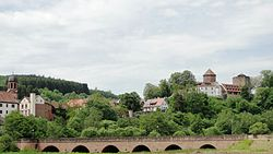 View of Rieneck with church, castle and bridge over the Sinn river