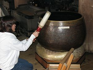 Standing bell - Rin being struck at Kiyomizu-dera, Kyoto