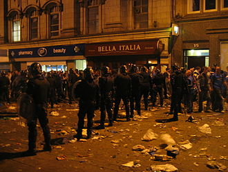 2008 UEFA Cup Final riots - Police lined up in riot gear in Piccadilly Gardens