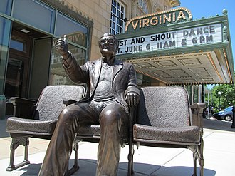 "Virginia Theatre (Champaign) - A statue of Roger Ebert giving his ""thumbs up"" outside the Virginia Theater."