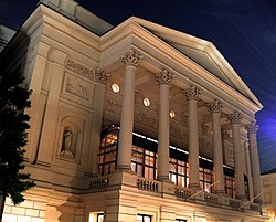 exterior shot of a classical facade of a large building