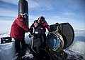 SECNAV greets the captain and the chief of the boat as he boards USS Hampton during Ice Exercise 2016. (25937051126).jpg
