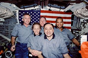 STS-98 - STS-98 crewmembers pose for the traditional inflight portrait on the flight deck of the Space Shuttle Atlantis.