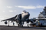 Sailors maneuver an AV-8B Harrier on the flight deck of the USS Wasp Sept. 21, 2016. (29761494722).jpg